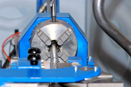 Spindle of turning lathe and metal detail. Selective focus. Stock Photo