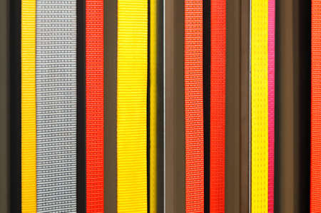 Yellow, gray, red, purple fabric ribbons as background
