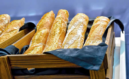 selectively: French bread baguettes in a wooden box. Shallow depth of field. Selectively tinted image Stock Photo