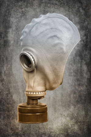 Gas mask on the ashen-gray background. Selective toning.