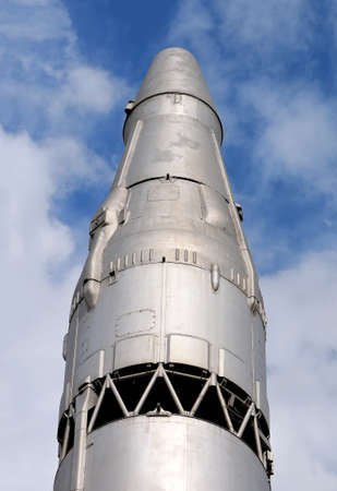 Head part of one of the first Soviet ballistic missiles capable of carrying a nuclear warhead on the blue sky background