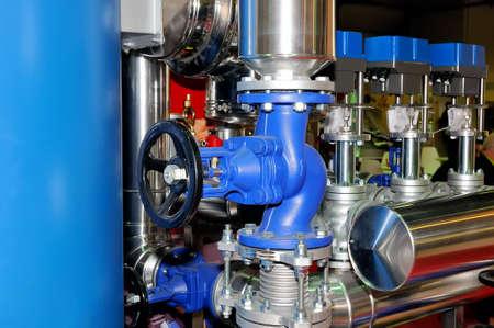 Industrial rotary valve and piping. Lizenzfreie Bilder