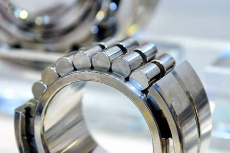 Industrial roller bearing on a light background. Shallow depth of field, selective focus