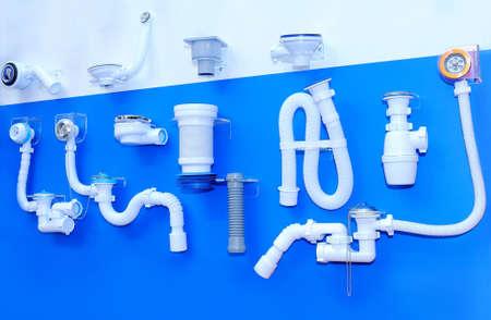 Plastic fittings for plumbing on a blue background Lizenzfreie Bilder