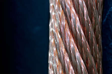 Twisted copper wires on a dark background. Macro shooting. Close up