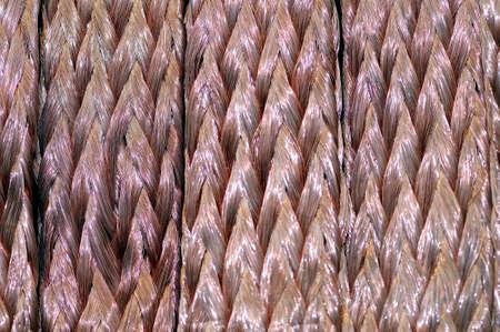 Verdrehte Kupferdrähte als Hintergrund. Makroaufnahme. Lizenzfreie Bilder - 85141334