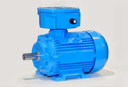 New blue electric motor isolated on gray background.