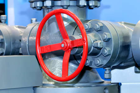 Red industrial valve on modern pipelines system