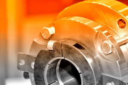 Steel parts for industrial machinery round shape. Red toning. Close up Lizenzfreie Bilder