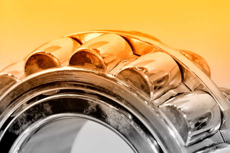 Industrial roller bearing on a light background. Red toning. Shallow depth of field, selective focus 스톡 콘텐츠
