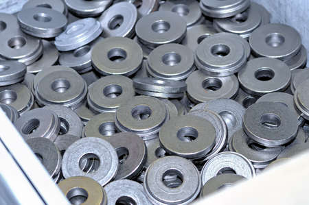 Lot of round metal magnets in bulk. Close up