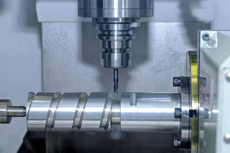 Metal billet is machined on an industrial milling machine.