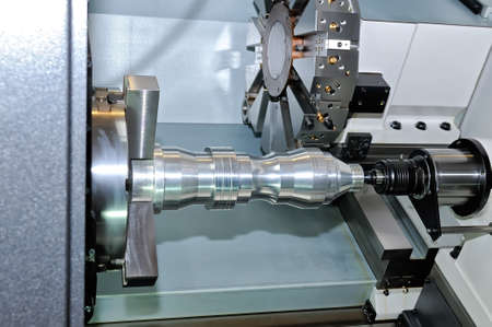 Metal detail is processed on the industrial lathe.