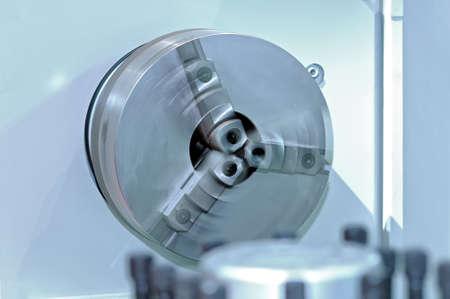 Rotating spindle of the industrial lathe. Spindle defocused in motion. Lizenzfreie Bilder