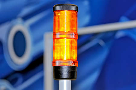 Emergency red lamp on abstract blue background.