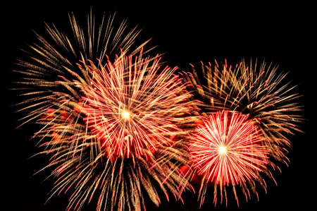 Amazing gold and red fireworks on dark background.