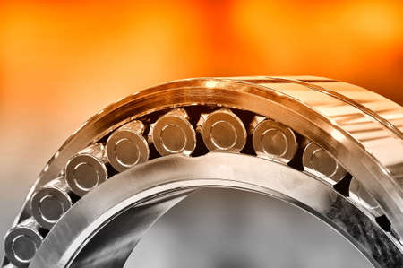 Industrial roller bearing. Red toning. Shallow depth of field, selective focus