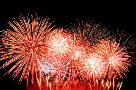 Amazing red fireworks on dark background. Lizenzfreie Bilder