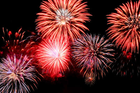 Amazing red and blue fireworks on black background.