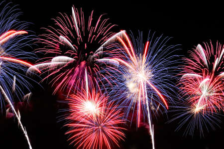 Amazing blue, white and red fireworks on dark background.