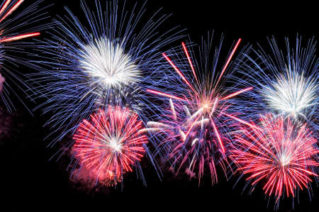 Amazing blue, white and pink fireworks on dark background