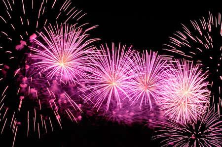 Amazing purple fireworks on black background.