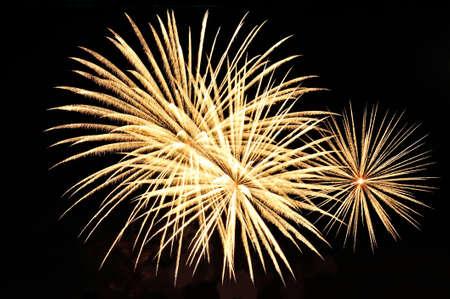 Amazing golden fireworks on black background.