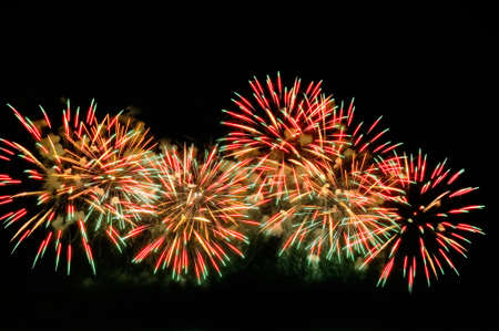 Amazing red-green fireworks on black background.