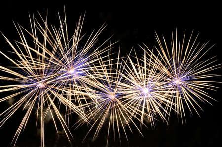 Amazing white-blue fireworks on black background. Lizenzfreie Bilder