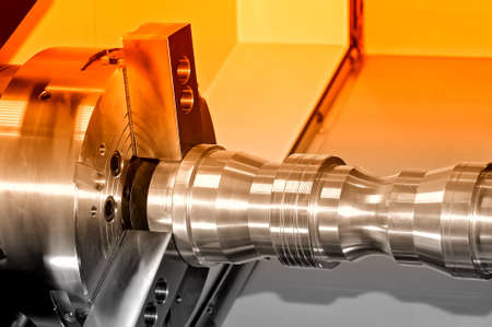 Metal detail in a spindle of the industrial lathe. Close up. Selective red toning Stock Photo
