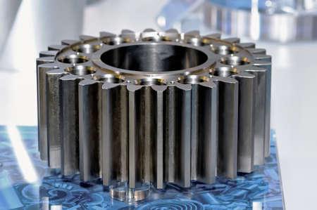 Industrial gear on a blue support. Small depth of sharpness Standard-Bild