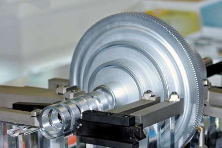 Metal industrial part is machined on an industrial machine lathe Standard-Bild
