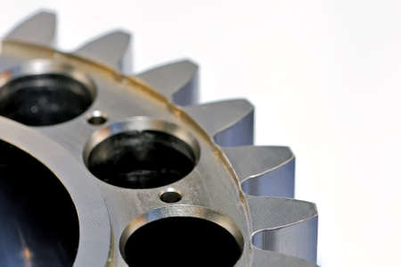 Industrial gear on light background. Small depth of sharpness. Close up