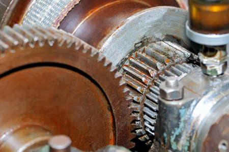 Rusty gears of the old industrial mechanism. Small depth of sharpness