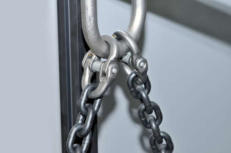 Metal lifting chains and carbines. Close up.