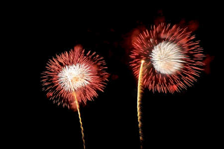 Amazing red and white fireworks on black background.
