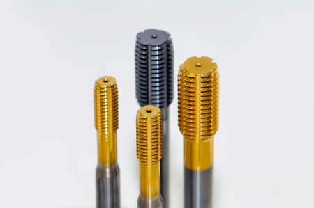 Screw taper taps cutting tool and broach  of the different sizes. Small depth of sharpness Stock Photo