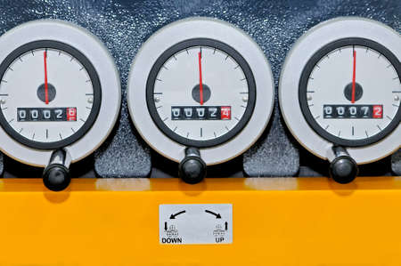 Industrial control measuring instruments with analog meters.