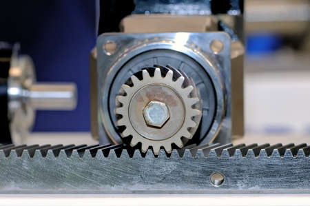 The industrial mechanism with the tooth gearing. Small depth of sharpness.
