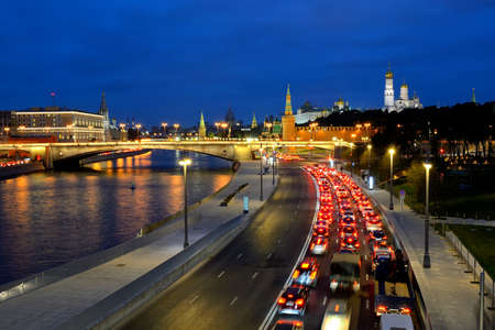 View from the pedestrian bridge in the park Zariadye in Moscow at the evening stopper traffic jam on the Moskva River embankment, on the Moskva River, the Kremlin. Cars are blurred in motion