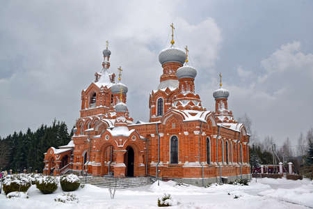 Ancient classical Russian Orthodox Christian church covered with snow