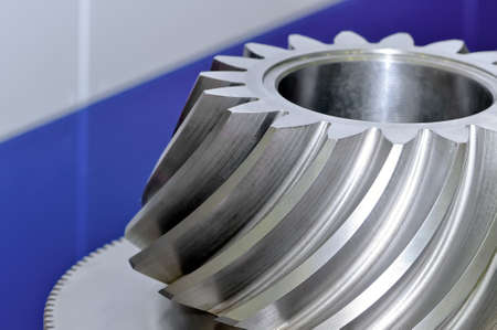 Industrial conical gear, cogwheel with spiral machine teeth. Macro shooting