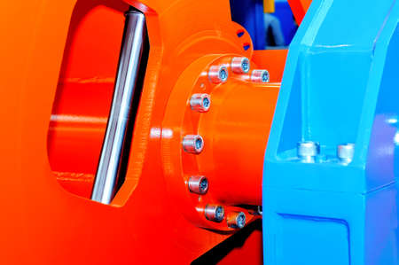 Parts of the industrial machinery, machine tools of red and blue color. Macro shooting Standard-Bild