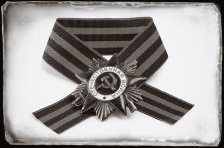 Soviet military order and award ribbon - symbols of the Victory Day in WWII on May 9, antique toned
