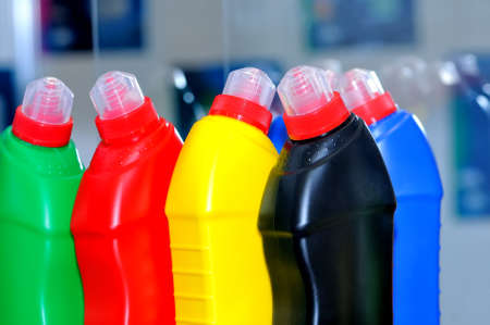 Multi-colored plastic bottles with household chemicals, plastic detergent bottles, cleaning and washing products Stock Photo