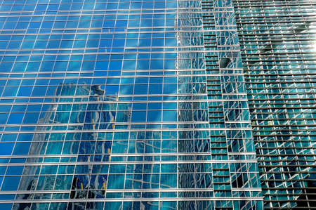 Moscow, Russia - June 2, 2018: High rise buildings of the Moscow International Business Center - Moscow City. Wall of a modern skyscraper with windows on a facade and specular reflection in windows