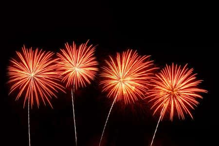 Orange and pink fireworks on dark background. Stock Photo