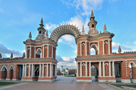 Moscow, Russia - November 21, 2018: Figured gate and decorative gallery in the Museum Park Tsaritsyno. Tsaritsyno is a big historical architectural complex, landscaped park with decorative ponds