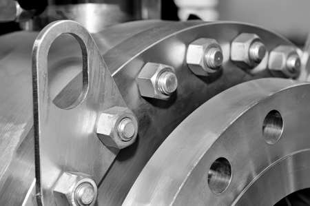 Steel parts for heavy industy machinery round shape. Black and white toned image. Close up.