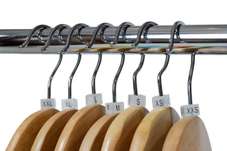 Wooden hangers with plastic sizes tags XXS, XS, S, M, L, XL, XXL are isolated on white Stock fotó